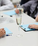 A glass of champagne in office _ success in business