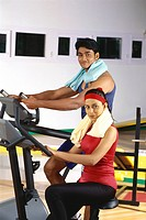 Man and woman doing exercise using equipment in gym MR415,416