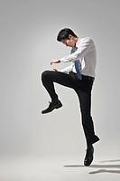 Businessman doing martial arts