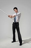 Portrait of a businessman holding stick