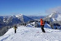 Two skiers downhill skiing on slope, Rosskopf, Spitzing, Bavarian Alps, Bavaria, Germany
