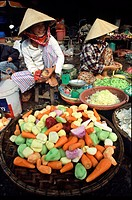 Two women selling vegetables at Dong Ba market, Hue, Vietnam, Asia