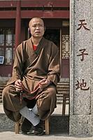monk with walkman, peak temple Zhu Rong Feng, Heng Shan south, Hunan province, Hengshan, Mount Heng, China, Asia