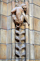 England, London, South Kensington, A carving of a monkey on a wall inside the Natural History Museum in London.