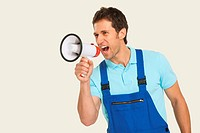 Man in overall shouting through megaphone