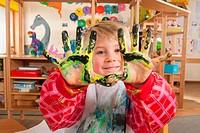 Germany, Boy 3_4 fingerpainting, showing hands, portrait