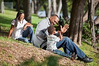 fort lauderdale, florida, united states of america, a father plays with his young son while the mother is watching