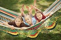edmonton, alberta, canada, three girls laying in a hammock