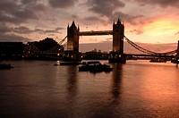 England, London, Tower Bridge, Tower bridge at dawn with Canary Wharf behind. The bridge was opened on 30 June 1894 by the Prince of Wales, the future...
