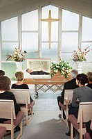 the deceased laying in a coffin at his funeral