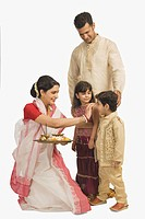 Family celebrating Durga Puja