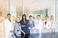 Businesswomen standing in a row in conference room
