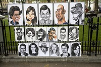 Street portrait artist cartoons famous people, Leicester Square, London, England