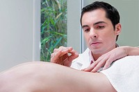 Acupuncturist applying needles on a person´s back