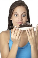Beautiful Caucasian woman eating a slice of chocolate cake