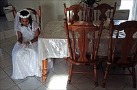Curacao, Santa Rosa, girl preparing for her first holy communion at home