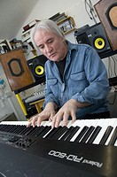 Rick Lloyd, former member of the British 80´s band the Flying Pickets playing keyboard in his home studio in Cwm Ystwyth village near Aberystwyth, Wal...