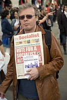 May Day march and rally at Trafalgar Square, May 1st, 2010 Man holding Socialist Party newspaper ´The Socialist´