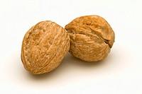 Two unshelled walnuts