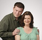 Loving married heterosexual couple posing for portrait