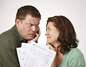 Married couple with United States 1040 tax forms feeling anxious about their taxes