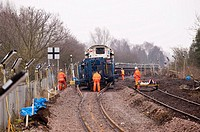 Workmen renewing the railway track near the station in Beccles , Suffolk , England , Britain , Uk