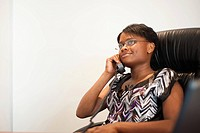 Woman in office on telephone, Johannesburg, Gauteng Province, South Africa