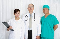 Doctor, female doctor and surgeon standing and looking at the camera