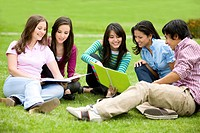 college or university students smiling and studying outdoors