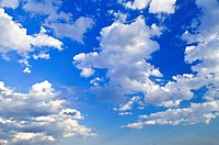 Background of blue sky with white cumulus clouds