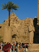 THE TEMPLE OF KARNAK, DEDICATED TO THE WORSHIP OF THE GOD AMON, DIVINE CREATOR OF THEBES, COLOSSAL STATUE OF RAMSES 2, NEAR LUXOR, HIGH EGYPT, EGYPT, ...