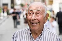 Portrait of happy senior man outdoors