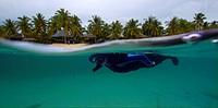 Free diver with Beach and Bungalows, Malapascua, Cebu, Visayan Sea, Philippines