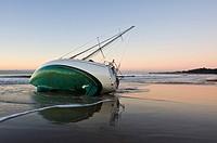 Santa Barbara, California: Sailboat washed ashore on beach during winter storm