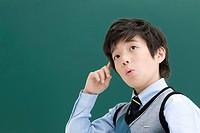 boy in front of blackboard