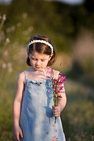 Little girl walking in the countryside