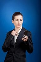 Businesswoman calling at phone