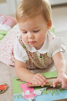 Knoxville, Tennessee, United States Of America, A Young Girl Playing With A Wooden Puzzle