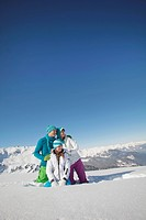 Couple and daughter in ski wear, looking away
