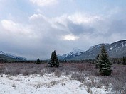 Clouds over snowcapped mountains, Banff National Park, Alberta, Canada