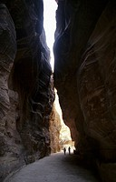 Bedouins walking inside Sik,narrow gorge that leads Khazneh Sik canyon Gorge of Petra Jordan
