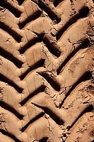 industrial tractor footprint on beach golden sand