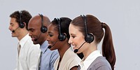 Multi_ethnic young business partners with headset on working in a call center
