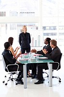 International business people clapping in a meeting