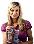 Young woman saving money