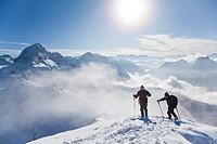 Two ski mountaineers on a mountain peak, Salzburger Land, Austria, elevated view