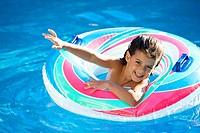 little girl waving happy in a swimming pool