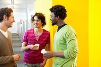 Businessmen drinking tea in an office