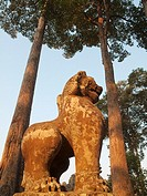 Cambodia - Lion statue at the Bayon, a temple in the centre of Angkor Thom, the ´Great Capital´ of the Khmer empire in Angkor  The temple complexes of...