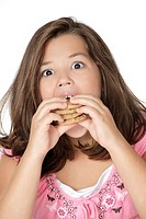 Cute Caucasian girl eating Chocolate Chip Cookies